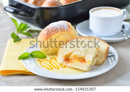 Sweet Austrian yeast pastry dumplings stuffed with apricot jam and served with vanilla sauce - stock photo