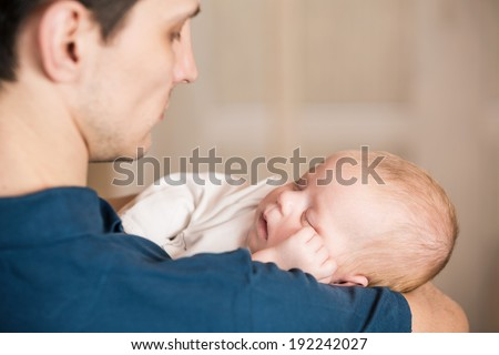 Sweet baby boy on father's shoulder - stock photo