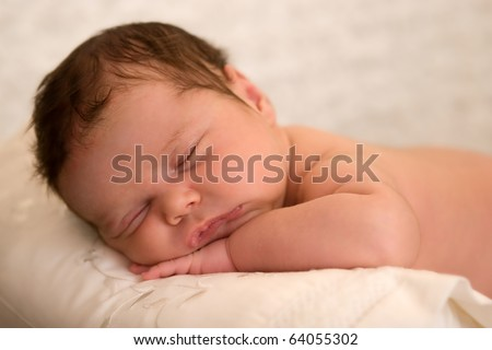 Sweet baby girl having a nap - stock photo