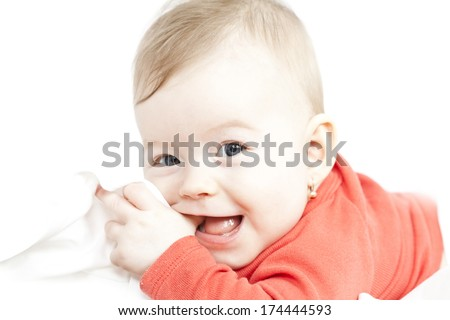 Sweet baby girl sucking on its finger  - stock photo