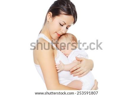 Sweet baby sleeping on hands mother - stock photo