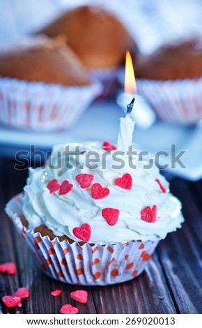 sweet baking, muffins on the wooden table - stock photo
