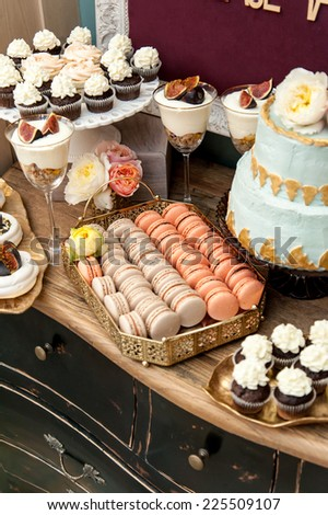 Sweet bar on wedding. Cake, cupcakes, sweetness and flowers. - stock photo