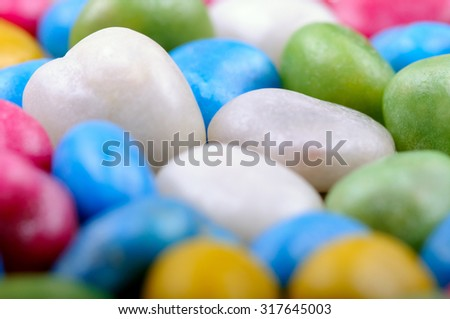 Sweet beans candies background. Closeup with extremely shallow DOF. - stock photo