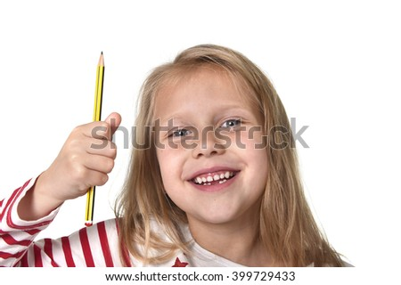 sweet beautiful female child 6 to 8 years old with cute blonde hair and blue eyes holding pencil isolated on white background in education and primary or junior school supplies concept  - stock photo