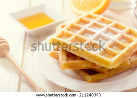Sweet Belgian waffles with sugar icing.Selective focus on the front waffles  - stock photo