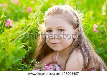 Sweet blonde little girl on the meadow with pink flowers - stock photo