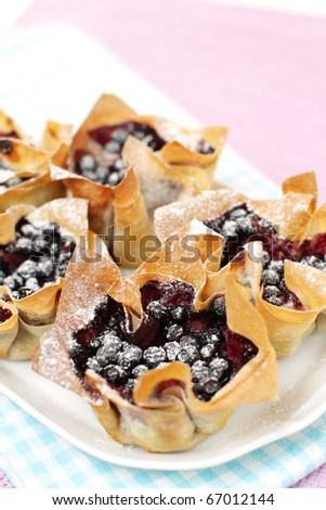 Sweet blueberries in a dough cup - stock photo