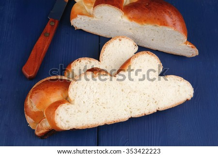 sweet bread : french bread cuts over blue wooden table - stock photo