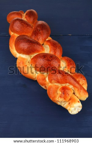 sweet bread : french bread over blue wooden table - stock photo