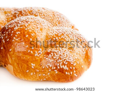 Sweet bread with sesame isolated on white - stock photo