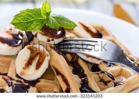 Sweet Breakfast (Waffles with Bananas and creamy Chocolate Sauce) - stock photo