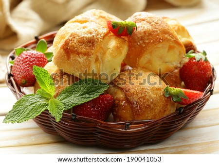 sweet buns with strawberries and sugar - homemade pastries - stock photo
