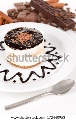 Sweet cake with chocolate on plate close-up - stock photo