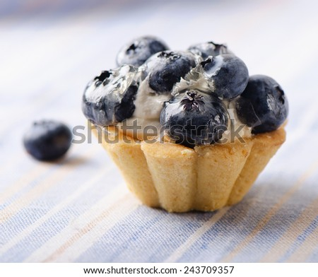 Sweet cake with fresh  blueberries. Selective focus - stock photo