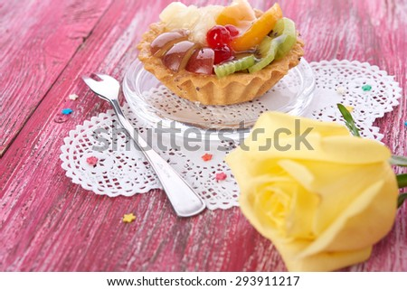 sweet cake with fruits on plate - stock photo