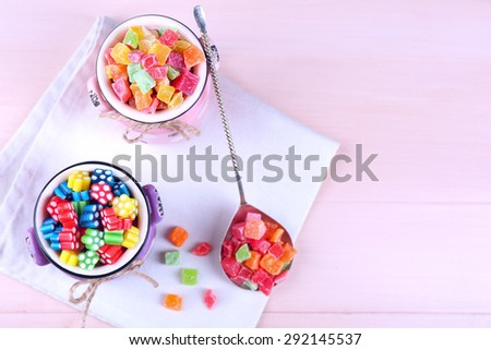 Sweet candies on wooden table, top view - stock photo