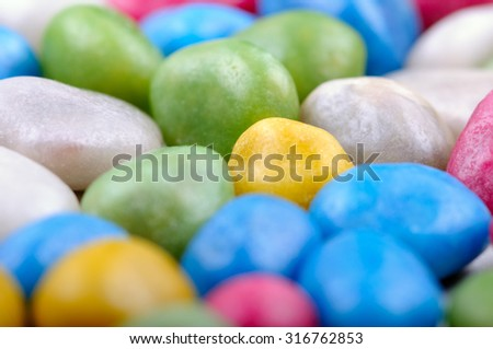 Sweet candy beans of different colors. Closeup with shallow DOF. - stock photo