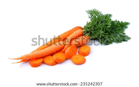 Sweet carrots with leafs on white background. - stock photo