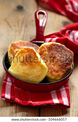 Sweet cheese pancakes on small skillet - stock photo