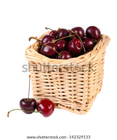 Sweet cherries  in a basket isolated on white - stock photo