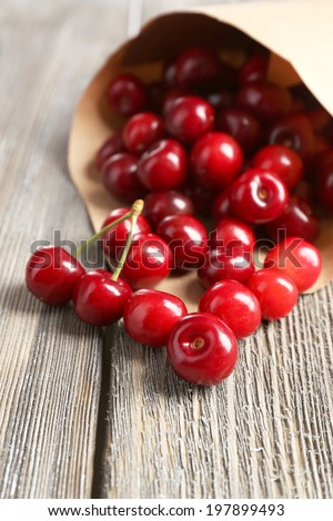 Sweet cherries on wooden table - stock photo