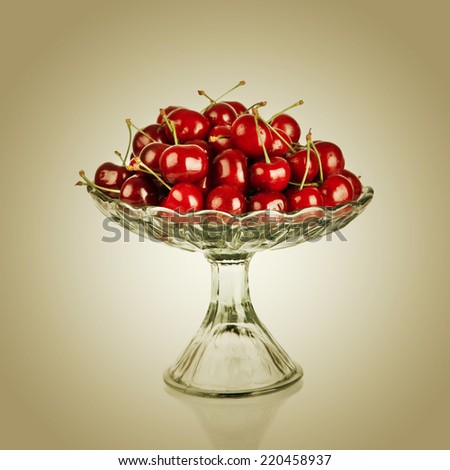 Sweet cherry in vase - stock photo
