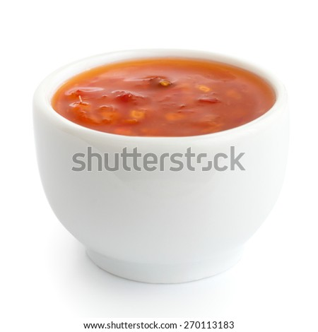 Sweet chilli sauce in small white dish. - stock photo