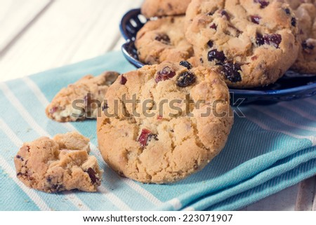Sweet chip cookies with dry cranberry,selective focus - stock photo