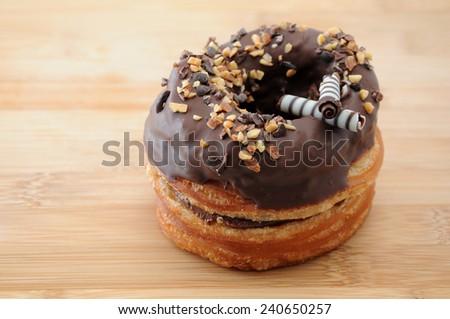 sweet chocolate almond cake doughnut on table - stock photo