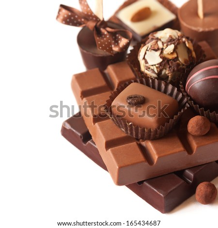 Sweet chocolate and truffles on a white background. - stock photo