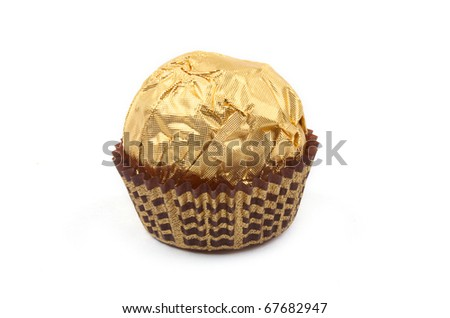 Sweet chocolate bonbon in golden foil on white background - stock photo