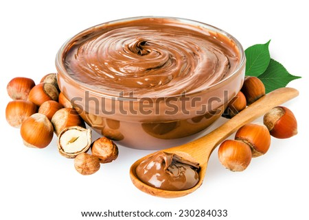 Sweet chocolate hazelnut spread with whole nuts isolated on white - stock photo