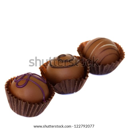 sweet  chocolate pralines isolated on white background - stock photo