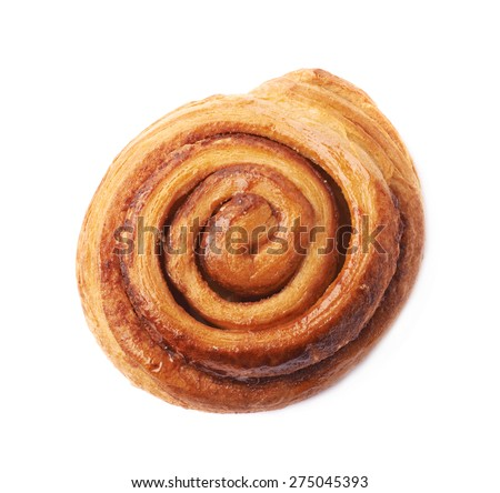 Sweet cinnamon bun roll swirl isolated over the white background - stock photo