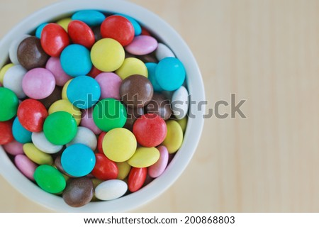 sweet color candy on the vase on the table - stock photo