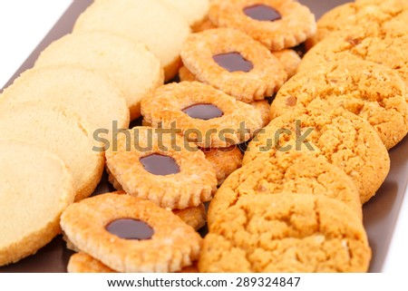 Sweet cookies on brown plate close up picture. - stock photo