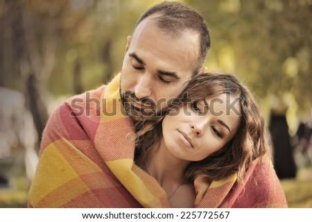 sweet couple in autumn park. portraits - stock photo