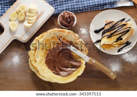 Sweet Crepes with chocolate cream. Top view - stock photo