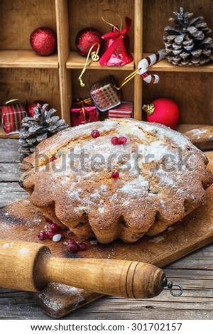 Sweet cupcake baked for the new year holiday on wooden table on  background of Christmas decorations.Photo tinted.Selective focus - stock photo