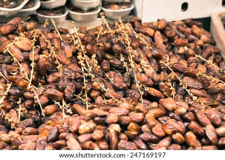 Sweet date fruits on market in Morocco. - stock photo