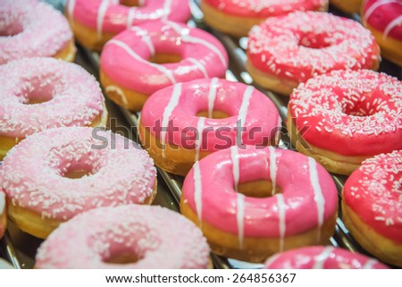 Sweet donuts arranged at display - stock photo