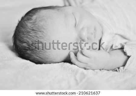 sweet dreams of newborn in soft focus black and white - stock photo