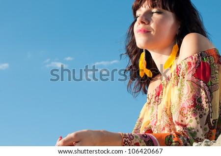 Sweet dreams: young caucasian woman enjoying summer time - stock photo