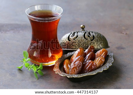 sweet dried dates in vintage silver plate - stock photo