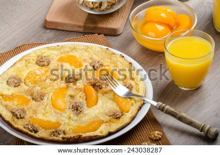 Sweet Egg omelet with walnuts, peaches - sprinkled with cinnamon and vanilla - stock photo