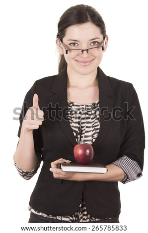 sweet female teacher holding red apple gesturing good work holding thumb up isolated on white - stock photo