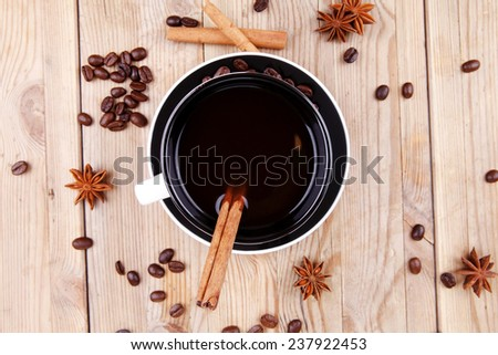 sweet food : black fragrant coffee and chocolate cake with cinnamon , coffee beans, and anise star - stock photo