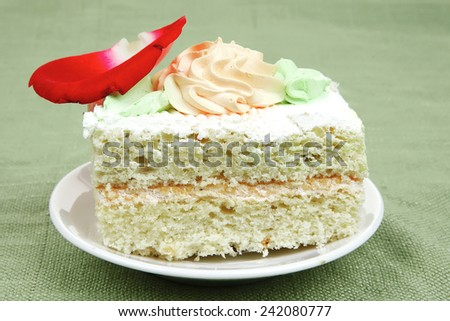 sweet food: cheese cream cake piece on white dish with roses - stock photo