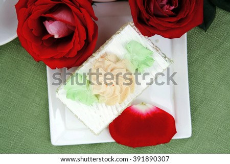 sweet food: tender cream cake served with rose - stock photo